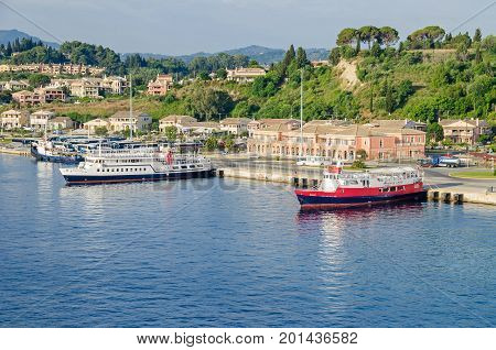 Corfu Greece - June 7 2017: Port of the Greek island Corfu the second largest of the Ionian Islands with passanger terminal and ferry boats