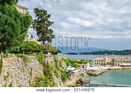 Corfu Greece - June 7 2017: View of the Faliraki beach (Alecos Baths) - one of the oldest public bathing spots- right behind the Palace of St.Michael and St.George with the part of a public garden around the Palace.