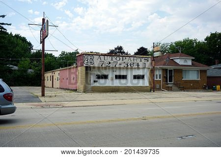 JOLIET, ILLINOIS / UNITED STATES - JULY 20, 2017: The Route 30 Auto Parts Store sits vacant on Plainfield Road.