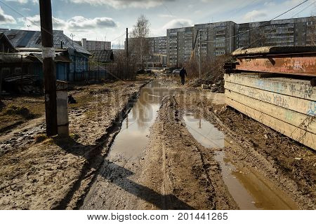 Yoshkar-Ola, Russia - April 27, 2015 Photo of mud and puddles in the street of Yoshkar-Ola, Russia