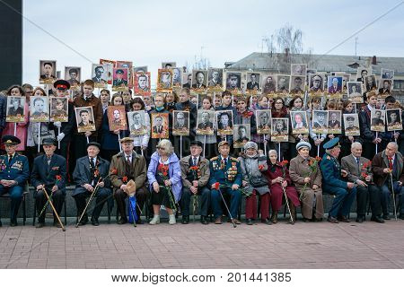 Yoshkar-Ola, Russia - April 28, 2015  Photo of the participants of the action Immortal Regiment - international social movement to preserve personal memory of the generation of the Great Patriotic War in the central park of Yoshkar-Ola, Russia