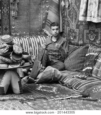 22ND JULY 2017,GOREME, TURKEY: Turkish male's repairing old antique Turkish rugs and carpets in a traditional Turkish carpet shop in Goreme, turkey, 22nd july 2017