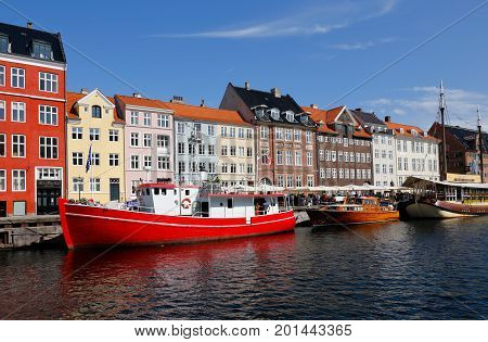 Copenhagen Denmark - August 24 2017: View of Nyhavn with moored ships in the canal.