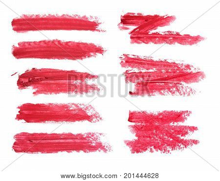 Set of red lipstick smudge isolated on white background. Smudged makeup product sample