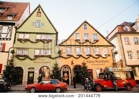 Rothenburg ob der Tauber, December 30, 2017: Decorated in a Christmas style car next to a toy store. Kathe Wohlfahrt Christmas decorations and toy shop. A popular toy store in Germany.