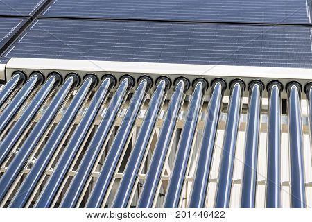 Solar Thermal Flat Panels with Evacuated Tube Collectors. Many companies are installing renewable energy sources to reduce their carbon footprint II