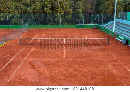 Large clay tennis court without people from above