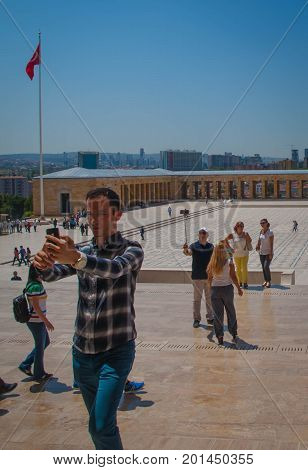 anKARA TURKEY - AUGUST 2 2017: tourist is making selfie in front of the square of Ataturk Mausoleum Anitkabir monumental tomb of Mustafa Kemal Ataturk