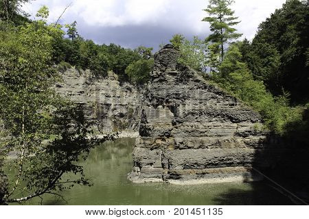 Rock outcropping in the bend of the Genesee river. Letchworth State Park in New Yorl