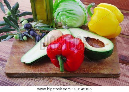 fresh raw vegetables prepared for cutting on wood