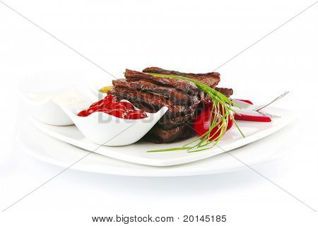 served meat and dishware on white dish