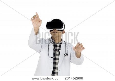 Picture of an Asian male doctor wearing virtual reality glasses while touching something isolated on white background
