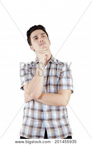 Portrait of a middle eastern male wearing casual clothes while thinking something isolated on white background