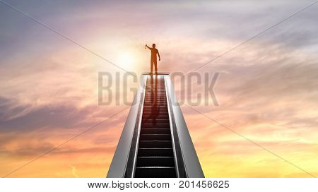 silhouette of people and Golden Medal on top of escalator with sunset concept as shampion or winner in bussiness