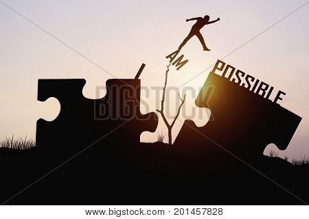 man jumping over jigsaw opposite possible shore concept as believe and faith to conncet business