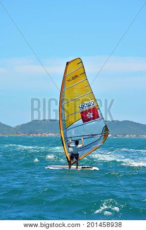 Buzios, Brazil - February 24, 2013: Windsurfing in the clear and calm waters of Buzios.