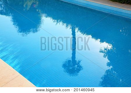 Clean blue water in swimming pool
