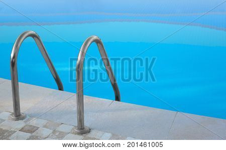 Swimming pool with stair and clean water outdoors