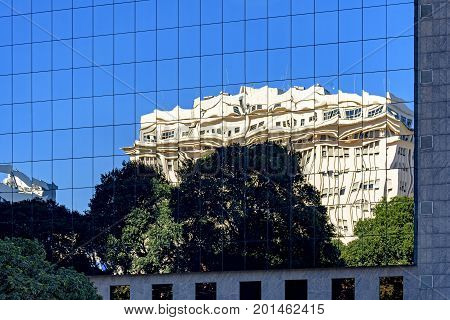 Commercial and business building with modern architecture and glass façade with reflections on the glass