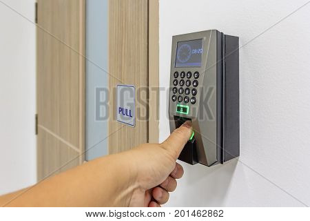 Yong man push down the electronic control machine to access the office door
