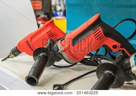 rotary hammer with a Hammer drill screwdriver Electric cordless hand drill in on the case Maintenance concept
