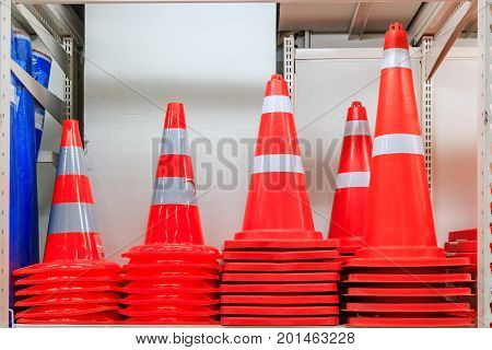 Row of Traffic safety cones ; road safety plastic cones on shelf