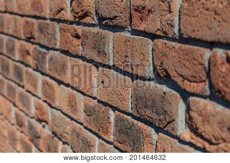 Retro brick wal background perspective with shallow depth of field