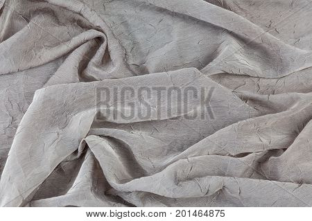 Folded silky smooth fabric background pattern texture