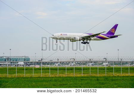 Bangkok Thailand - July 30 2017: Thai Airways Plane(Boeing 777) landing to runways at Suvarnabhumi international airport in Bangkok Thailand. This airport is one of the most populated airports in the world.