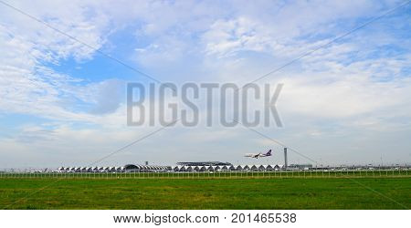 Bangkok Thailand - July 30 2017: Thai Airways or Thai smile Plane landing to runways at suvarnabhumi international airport in Bangkok. This airport is one of the most populated airports in the world. with copy space