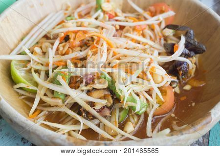 Papaya salad Som tumTraditional spicy Thai food.