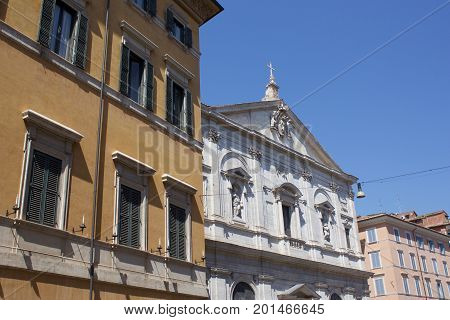 Roman Catholic Church between buildings in Rome, Italy