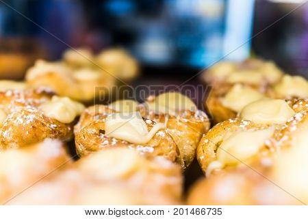 Closeup Of Danish Pastries On Tray In Bakery With Lemon Cream Filling