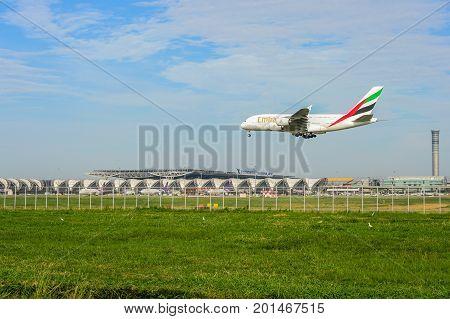 Bangkok Thailand - July 30 2017: Emirates plane landing to runways at suvarnabhumi international airport in Bangkok Thailand. This airport is one of the most populated airports in the world.