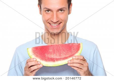 Smiling young man holding a slice of watermelon isolated on white background