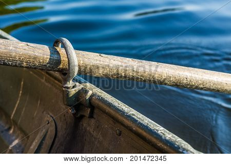 Row Boat Oar Lock Closeup In Hole During Summer With Water