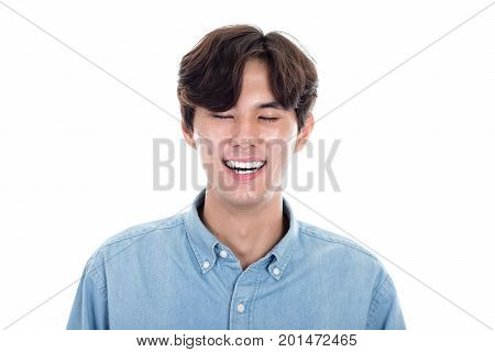 Studio portrait of an asian man laughing outrageous