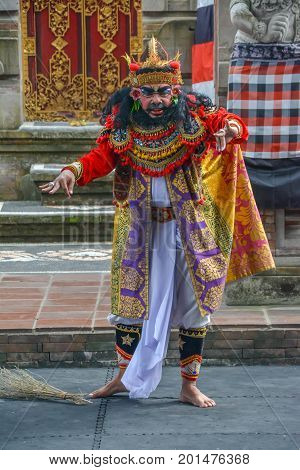 Denpasar, Indonesia - August 15, 2017: A regal character in a traditional Barong ceremony in Bali. The depiction of the battle between good and evil intertwines local history and mythology to create a parable for all ages.