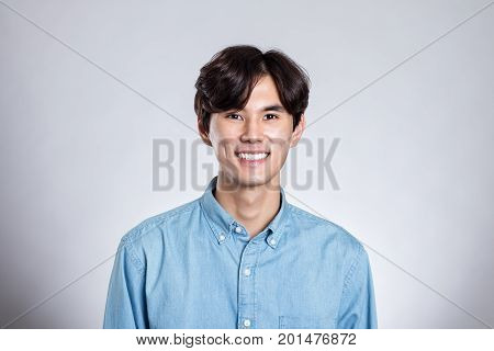 Portrait of Asian young man smiling looking at camera
