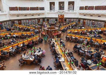 Melbourne Australia - July 29 2017: State Library of Victoria reading room filled with people reading and studying