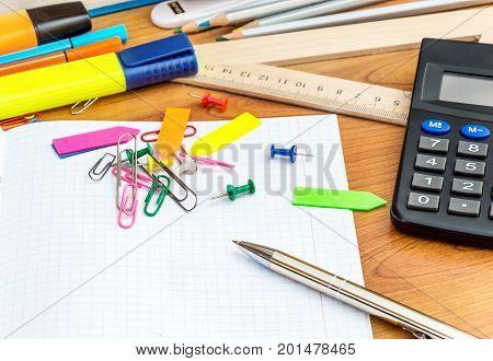 School desk with the school supplies. Back to school concept.