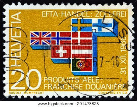 SWITZERLAND - CIRCA 1967: A stamp printed in Switzerland shows flags of European Free Trade Area countries, circa 1967.