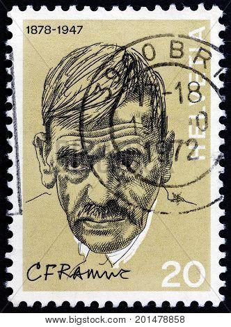 SWITZERLAND - CIRCA 1972: A stamp printed in Switzerland shows novelist Charles Ramuz, circa 1972.