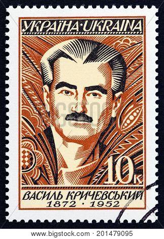 UKRAINE - CIRCA 1997: A stamp printed in Ukraine issued for the 125th anniversary of the birth of V.G.Krichevskyi shows painter Vasyl Krichevskyi, circa 1997.
