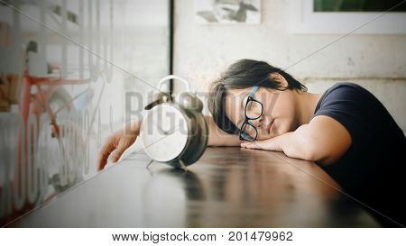 Asian Women Sleep In Coffee Shop Cafe With Clock