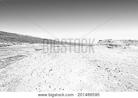 Rocky hills of the Negev Desert in Israel. Wind carved rock formations in the Southern Israel Desert. Black and white picture