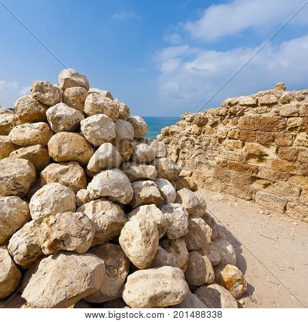 Ruins of the crusader fortress of the city Arsour in Israel. Ballista stones near the inner gate of fortification in the Israeli Apollonia national park.