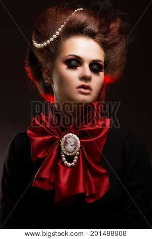 Girl in gothic art style with creative makeup. image for Halloween. Photo taken in studio