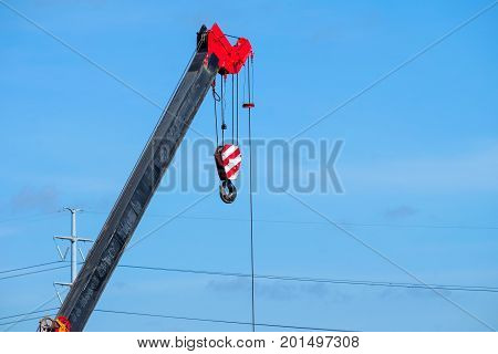 Close up crane with hook on sky background
