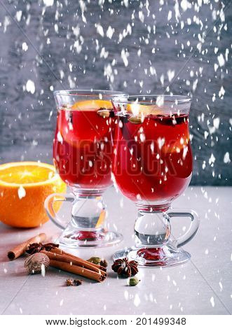 Christmas mulled wine or gluhwein with spices and orange slices